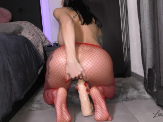 Horny MILF in red fishnets fucks her oiled ASS with a big dildo!