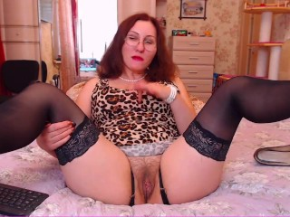 Lady is playing with her hairy pussy