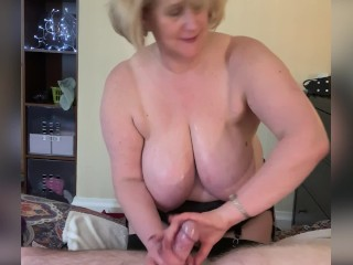 Big Tit Mom Gives a filthy Oily Hand Job.