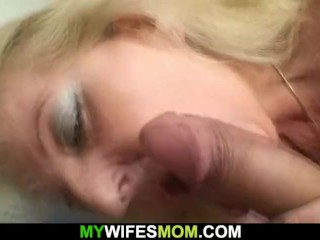 Hairy blonde grandma in white lingerie rides his big cock