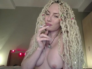 Hot blonde with big tits sensual smoking topless in front of cam