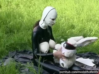 Rubber Girl Full in Black Latex Catsuit and Mask Plays with herself Outdoor in a Meadow - Part 3