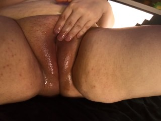 Chubby redhead oils up soft fat pussy
