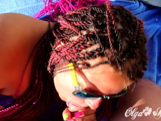 I gave a blowjob to my man on the beach in full view of everyone and he doused my pigtails with cum