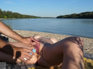 Risky outdoor masturbation with an electric toothbrush for big tits milf while a ship is passing by