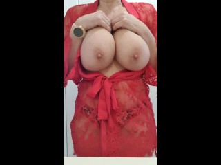 Mature lady with huge boobs playing with her nipples and big tits