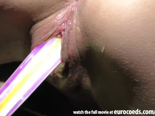 glowstick gaping her pussy and stuffing her pussy full to the stretching
