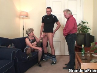 Horny old lady enjoys two cocks from both sides