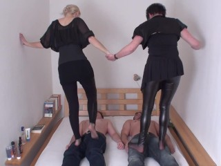 aunt and niece trample together two slaves
