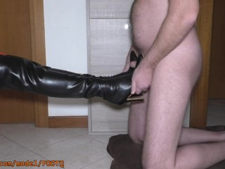 Male sub got horny with mistress boots and red stockings. He fucked her boots and jizz on them.