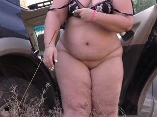 bbw takes off her thong panties near the car