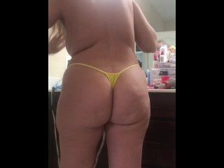 My pawg wife fixing her hair in bright yellow thong