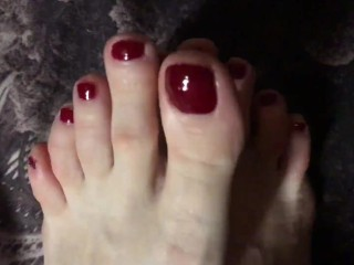 Red painted toenails close up