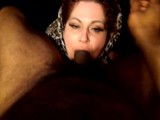 Dipping in hijab Nuggie's mouth while cuffed.