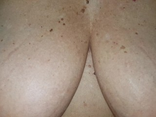 Mature lady with  huge boobs suck and licks her big tits and nipples