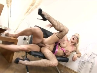 Sexy blonde with glasses fucked in fishnet stockings and high heels