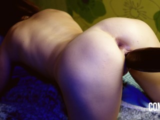 Spanked her hot ass with a big black dildo