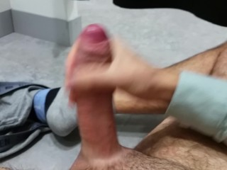 Amateur guy moaning softly while masturbating in a changing room