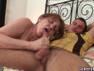 Injured old granny getting healed by young cock
