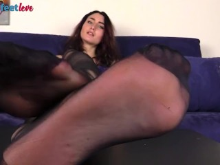 Redhead wearing black pantyhose shows off firm ass and feet