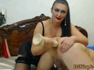 Mistress massaged his hole and inserted huge dildo there
