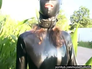 Rubber Girl Full in Black Latex Catsuit and Mask Plays with herself Outdoor in a Meadow - Part 4