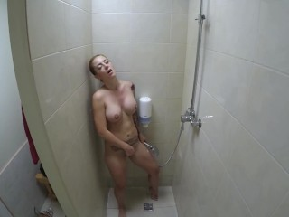 Kinky milf loves masturbating in the gym shower and pissing