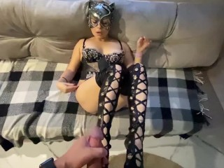 The catwoman makes a smacking blowjob and gets fresh sperm on her sexy feet in leather pantyhouse