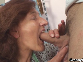 Clothed old grandma sucs and rides younger dick